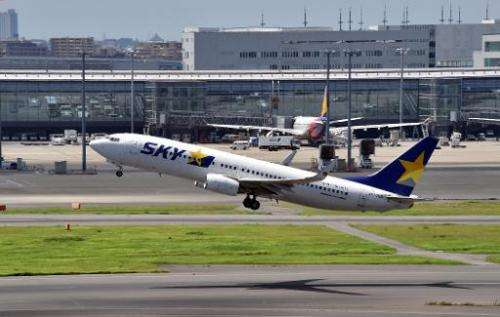 An airliner of Japan's Skymark Airlines takes off from Tokyo's Haneda airport, on August 19, 2014