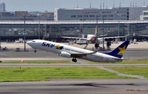 Japan says electronics OK during take-off and landing