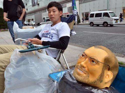 An Apple gadget fan queues outside an Apple store for the iPhone 6 release in Tokyo, on September 10, 2014