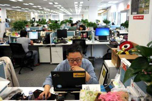 An employee is seen using a computer at Sina Weibo office, widely known as China's version of Twitter, in Beijing, on April 16,