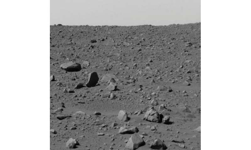 """An image captured by the Mars rover """"Spirit"""" and released by NASA on March 6, 2004 shows a view of the rocky terrain o"""
