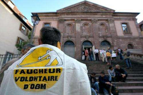 Anti-GMO demonstrators protest in front of Colmar courthouse on September 28, 2011 in eastern France