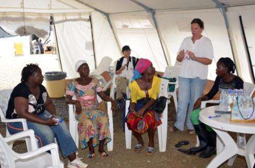 A nurse speaks to women who survived the Ebola virus during a training to become advisers for patients suffering from the diseas