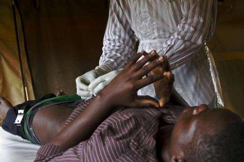 A patient is fitted with a non-surgical circumcision device called PrePex in Mukono on May 12, 2014, it is hoped it could cut HI