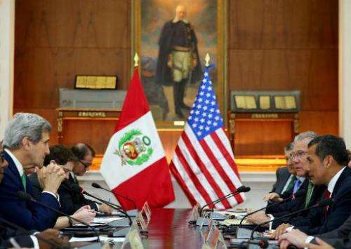 A picture distributed by the Peruvian presidency press office shows US Secretary of State John Kerry (L) in a working session wi