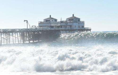 A pier near Malibu, California, is pictured during huge ocean swells generated by hurricane Marie, on August 27, 2014