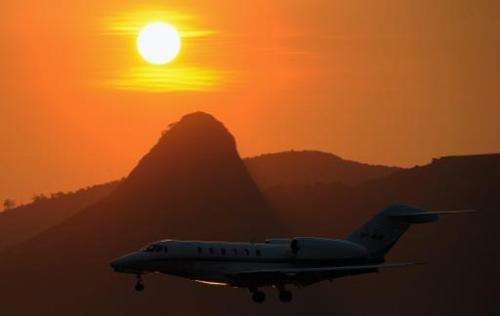 A plane land in Rio de Janeiro, FIFA estimates the World Cup will produce 2.7 million tonnes of C02 emissions