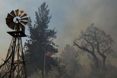 A ranch is left a smoldering ruin by the Cocos fire, in San Marcos, California, on May 15, 2014