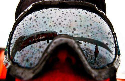 Argentinian military base of Camera is reflected on a scientist's glasses in Antarctica during a mission of the Brazilian Navy's