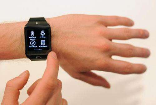 A Samsung employee demonstrates the new SM-R381 Smartwatch, during the Tizen Developer Conference in San Francisco, California,