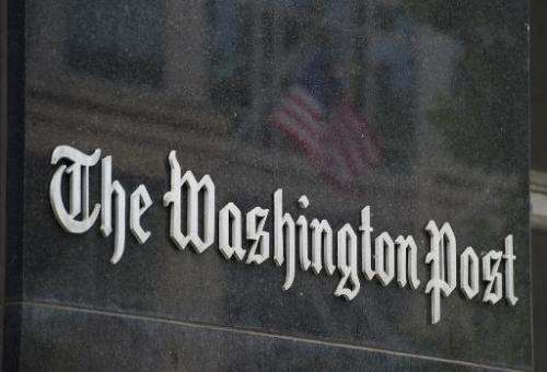 A sign hangs on the outside of the Washington Post Building, August 6, 2013 in Washington