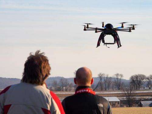 A small remote-controlled drone hovers in the sky at a meet-up of the DC Area Drone User Group on February 1, 2014