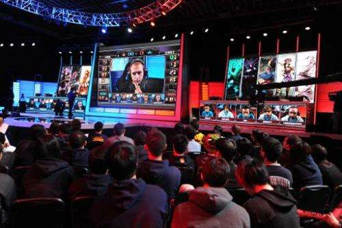 A studio audience watches a match between professional Team Curse and Cloud 9 during the League of Legends North American Champi