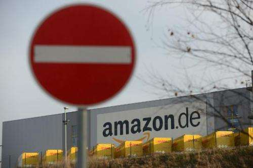 A traffic sign forbidding trespassing stands in front of the logistics center of internet retail giant Amazon in Bad Hersfeld, c