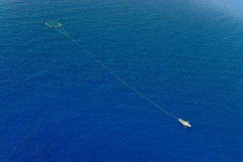 A tuna fishing boat drags nets through the Mediterranean sea during a Greenpeace protest action against overfishing of red tuna
