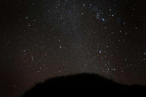 A view of a meteor shower over the National Park of El Teide on the Spanish canary island of Tenerife, on December 13, 2012