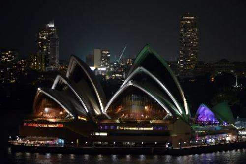 A view of Australia's iconic landmark Sydney Opera House during the annual Earth Hour on March 23, 2013, one minute brightly lit