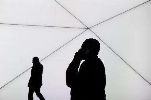 A visitor speaks on his phone in Barcelona on February 25, 2014, on the second day of the 2013 Mobile World Congress