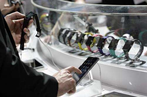 A visitor tests the Sony SmartWatch 2 during the 2014 Mobile World Congress in Barcelona on February 25, 2014