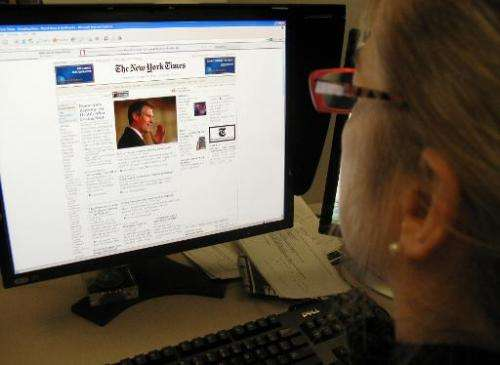 A woman reads the online version of the New York Times on January 20, 2010
