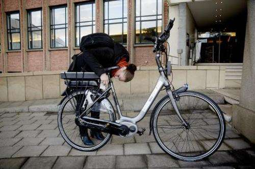 "A woman tests an ""intelligent"" bike with special safety technology in The Hague, Netherlands, on December 15, 2014"