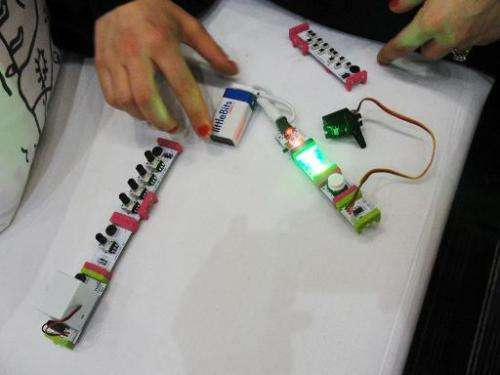Ayah Bdeir, founder and chief of startup littleBits, works with one of her creations March 21, 2014 at the TED conference in Van
