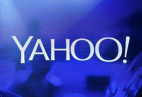 A Yahoo! logo is shown on a screen during a keynote address by President and CEO Marissa Mayer on January 7, 2014 in Las Vegas,