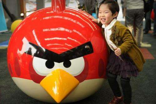 A young girl plays at Shanghai''s first Angry Birds Activity Park  on October 31, 2012