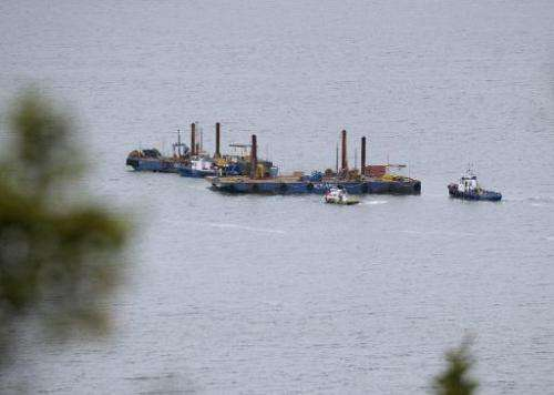 Barges conduct seismic tests in the St. Lawrence river in Cacouna, Quebec on September 23, 2014, in order to build an oil termin