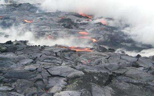 Breakouts of lava from Hawaii's Kilauea volcano are seen near the West end of Wilipe, Hawaii, on July 31, 2002