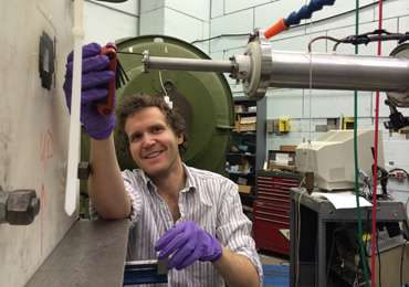 Building a neutrino detector with scraps and ingenuity