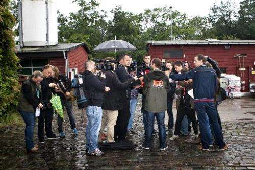 CEO of Copenhagen Zoo Steffen Straede (C back turned) speaks with the media on July 11, 2012