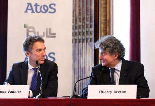 CEO of the IT services company Atos Thierry Breton (R) and Philippe Vannier, new CEO of French group Bull, hold a press conferen