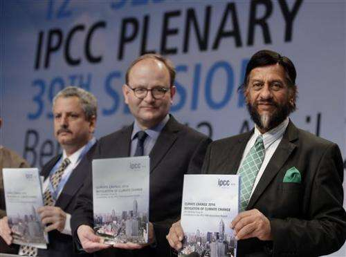 Climate panel says emissions rising, avoids blame