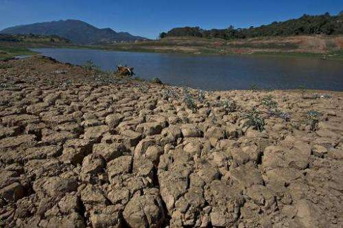 Cracked earth in an area that used to be underwater in the Jaguari dam, during a drought affecting Sao Paulo state, on August 19