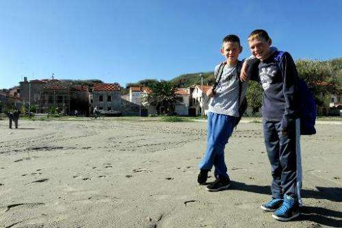 Dominik Malovic (L) and Ivan Macic (R) posing on beach near their school on the small remote island of Susak in Croatia's northe