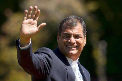 Ecuador's President Rafael Correa waves at the press in Vina Del Mar, Chile on March 11, 2014