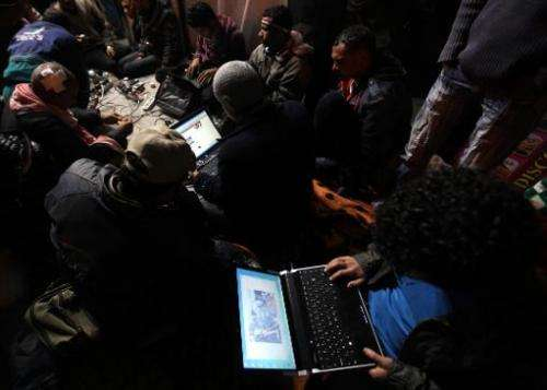 Egyptian anti-government bloggers work on their laptops from Cairo's Tahrir square on February 10, 2011