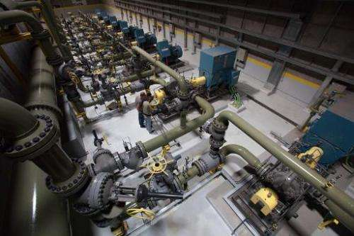 Emplyees work in the pump room at the Gorona power station on El Hierro island on March 28, 2014