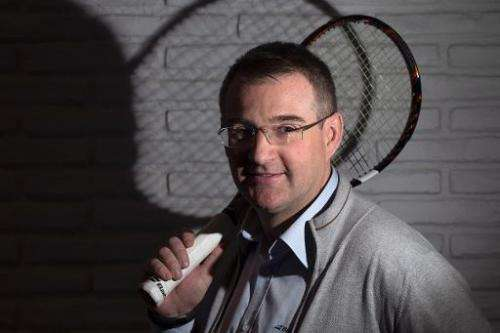 Eric Babolat, the CEO of a company specialized in tennis equipment, poses with a new 'connected' racket, in Paris, on March 13,