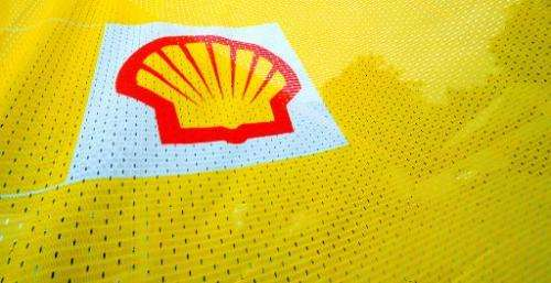 e Shell logo is seen on a flag outside a Shell petrol station in Fleet, Hampshire in southern England on July 29, 2010