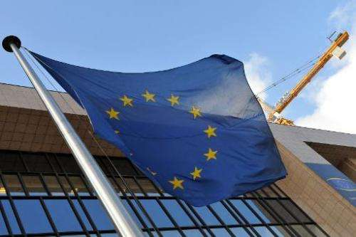 EU flag is seen in front of the EU Commission headquarters in Brussels on March 14, 2013