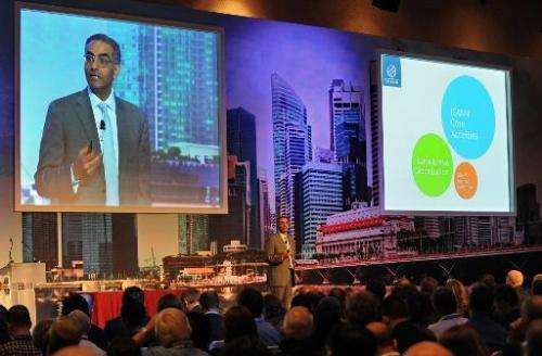 Fadi Chehade (C), President and CEO of ICANN, speaks during the opening of the ICANN Singapore meeting on March 24, 2014