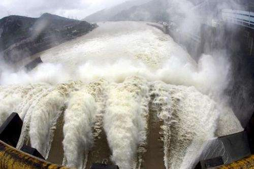 File picture of water being discharged from a reservoir at the Shuikou Dam in southeastern China's Fujian province on May 24, 20