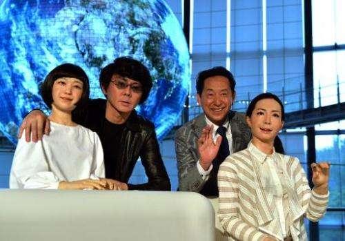 Former astronaut  Mamoru Mori (2nd R), and Osaka University professor Hiroshi Ishiguro (2nd L) pose with new female humanoid rob