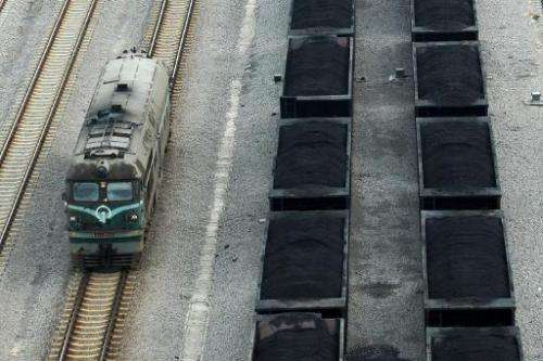 Freight rail carriages filled with coal are seen parked inside a coal mining facility in Huaibei, in northern China's Anhui prov