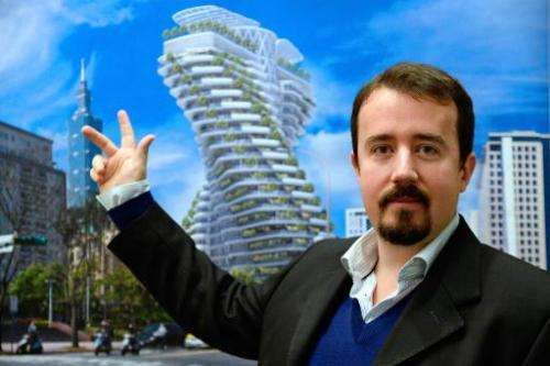 French architect Vincent Callebaut poses as he presents a picture of one of his futuristic projects on January 10, 2014 in Paris