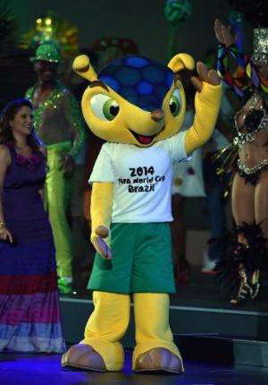 Fuleco the official mascot of the 2014 FIFA World Cup in Brazil dances on stage in Sao Paulo on June 10, 2014