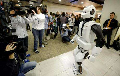 Humanoid robot REEM-C of Pal Robotics moves in front of journalists during the 2014 IEEE-RAS International Conference on Humanoi