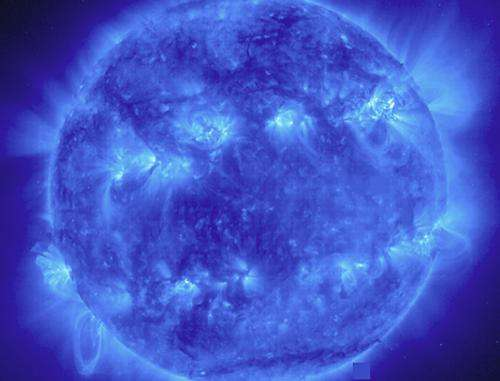 Image of solar activity shows two bright bands circling the Sun